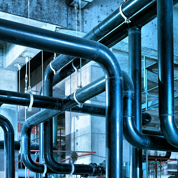 Pipes in factory to promote Powell Commercial Insurance Brokers - Commercial Combined Insurance