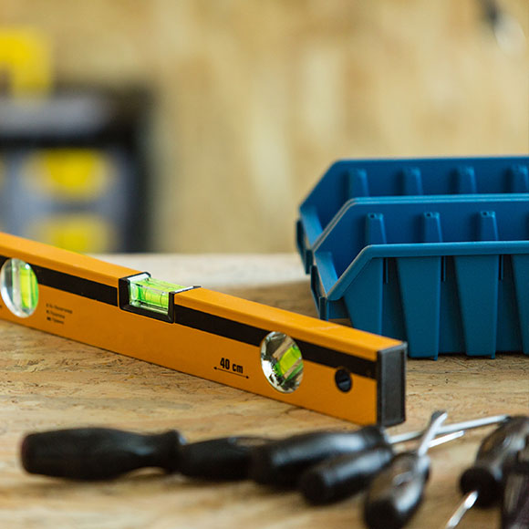 Spirit level and tools to promote Powell Commercial Insurance Brokers - Contractors Combined Insurance
