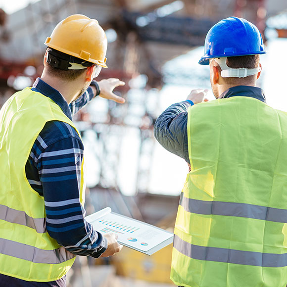 Two construction workers overseeing site to promote Powell Commercial Insurance Brokers - Contractors Combined Insurance