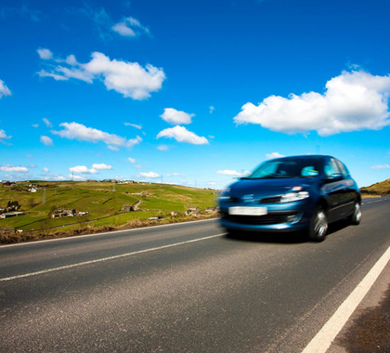 Car driving down road to promote Powell Commercial Insurance Brokers - Motor Fleet Insurance