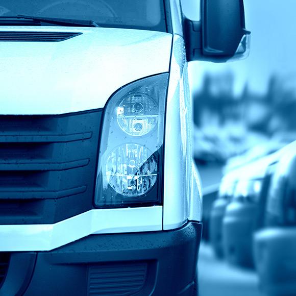 Van driving down road to promote Powell Commercial Insurance Brokers - Motor Fleet Insurance