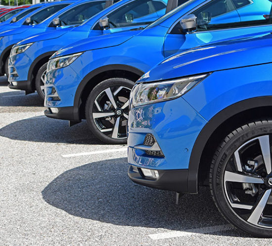 Blue cars parked in a line - car park - to promote Powell Commercial Insurance Brokers - Motor Fleet Insurance