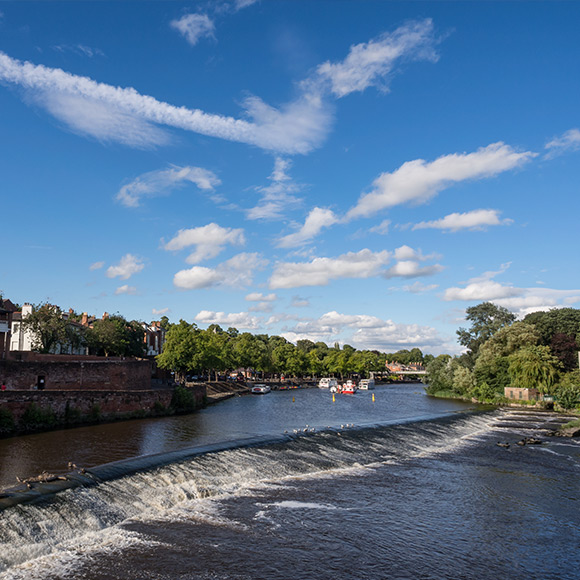 Weir in River Dee, Chester to promote Powell Commercial Insurance Brokers