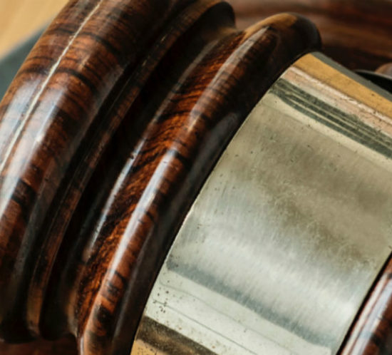 Judges hammer to promote Powell Commercial Insurance Brokers - Liability Insurance