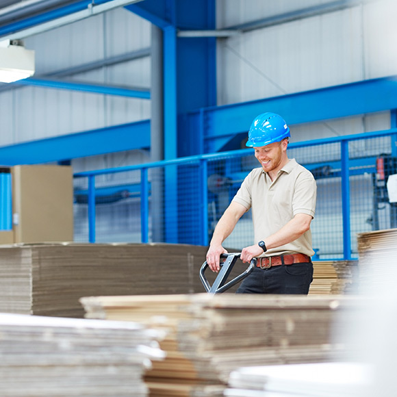 Packaging operator in action to promote Powell Commercial Insurance Brokers - Goods in transit Insurance