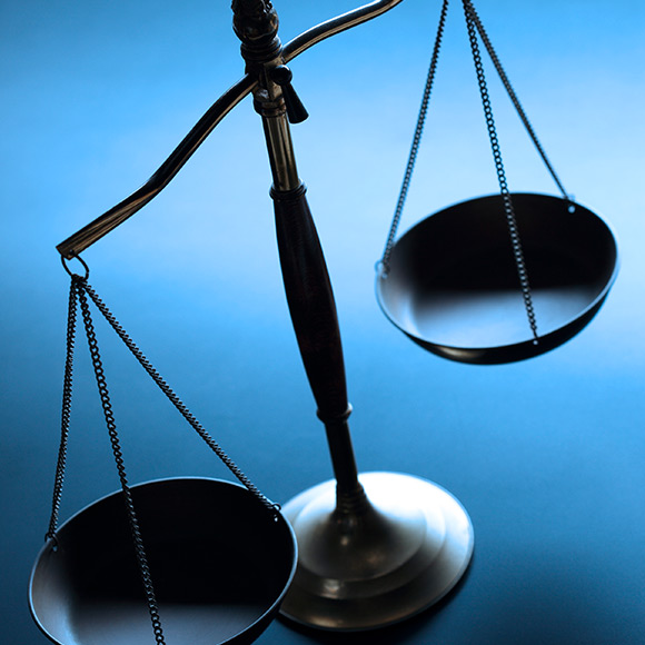 Balancing scales to promote Powell Commercial Insurance Brokers - Professional Indemnity Insurance