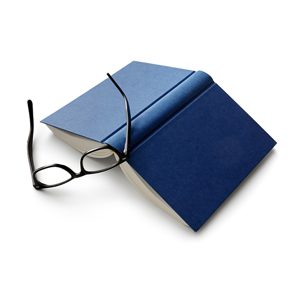 Blue book and glasses to promote Powell Commercial Insurance Brokers